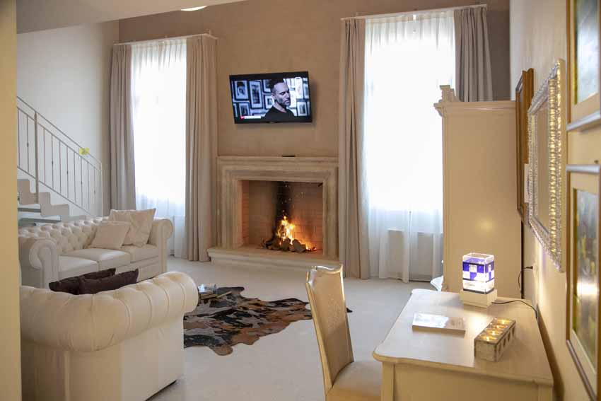 beautiful authentic venetian villa of 16th century interior design with fireplace and carpet